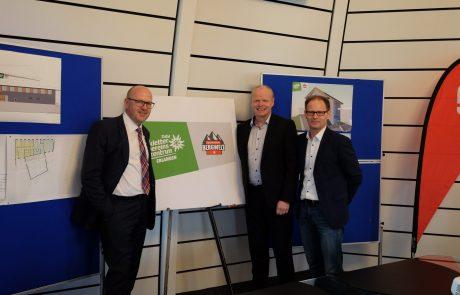 Johannes von Hebel (SPK), Kai Lenfert (DAV) und Ulrich Klement (Sportamt) präsentieren das auf ein Schild gedruckte neue Logo.
